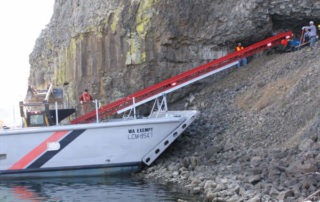 Conveyor on boat conecting to land